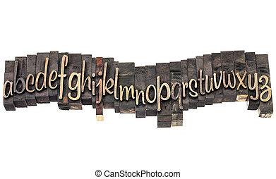 alphabet in script wood type