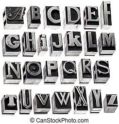alphabet in vintage metal type