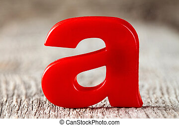 First letter of alphabet on the wooden background