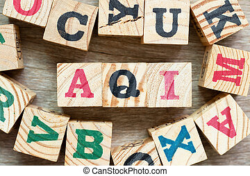 Alphabet letter block in word AQI (Abbreviation of air quality index) with another on wood background