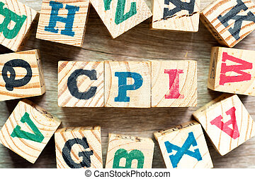 Alphabet letter block in word CPI (abbreviation of consumer price index) with another on wood background
