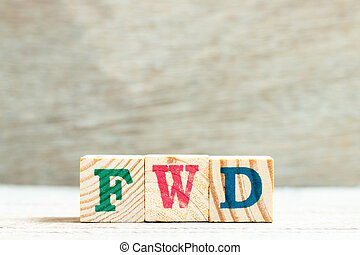 Alphabet letter block in word FWD (Abbreviation of forward) on wood background
