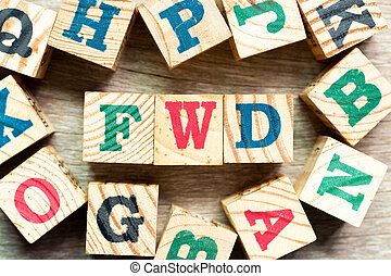 Alphabet letter block in word FWD (Abbreviation of forward) with another on wood background