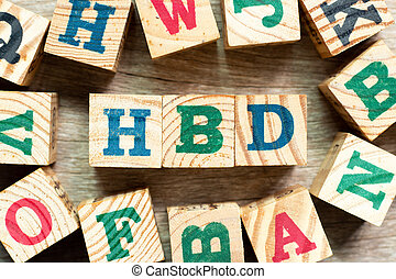 Alphabet letter block in word HBD (Abbreviation of happy birthday) with another on wood background