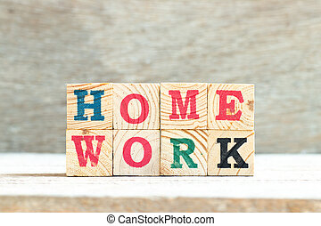 Alphabet letter block in word homework on wood background