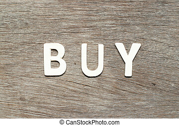 Alphabet letter in buy on wood background
