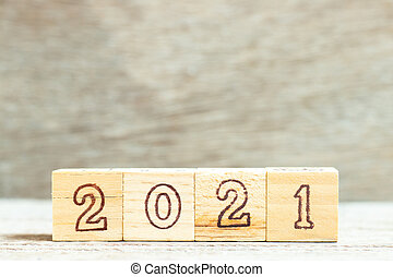 Alphabet letter in word 2021 on wood background