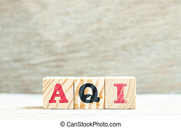 Alphabet letter in word AQI (Abbreviation of air quality index) on wood background