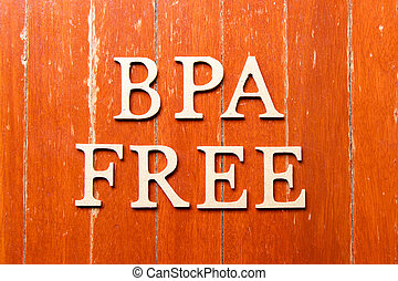 Alphabet letter in word BPA (abbreviation of Bisphenol A) free on old red color wood plate background