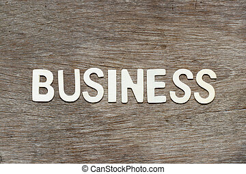Alphabet letter in word business on wood background