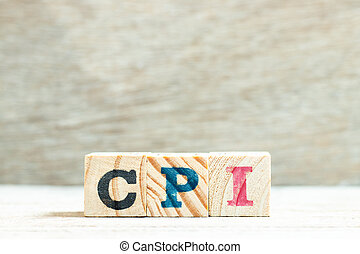 Alphabet letter in word CPI (abbreviation of consumer price index) on wood background