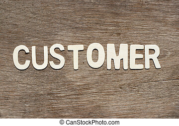 Alphabet letter in word customer on wood background
