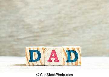 Alphabet letter in word dad on wood background