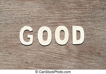 Alphabet letter in word good on wood background