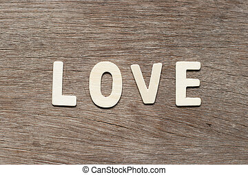 Alphabet letter in word love on wood background