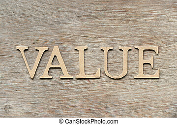 Alphabet letter in word value on wood background