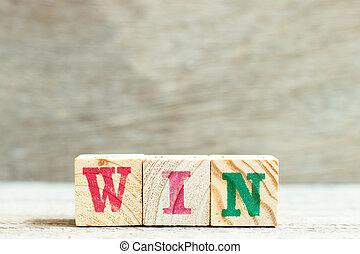 Alphabet letter in word win on wood background
