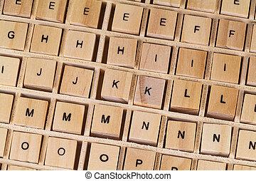 Alphabet letters written on wooden cubes