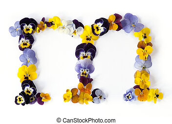 Alphabet made from pansy flowers, letter M