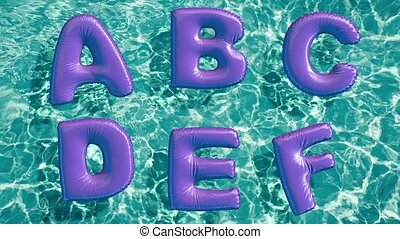 alphabet made of shaped inflatable swim ring floating in a...