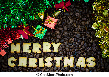 "alphabet ""merry christmas"" made from bread cookies on coffee beans background"