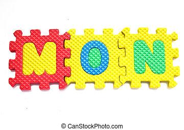 "Alphabet ""mon"" Puzzle Pieces on White Background"