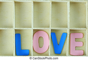 alphabet of LOVE in wooden box.
