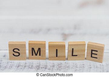 Alphabet smile word on white old vintage wood