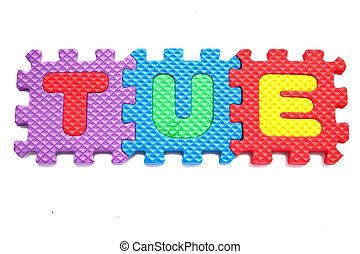 "Alphabet ""tue"" Puzzle Pieces on White Background"