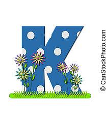"The letter K, in the alphabet set ""wildflower Meadow"", is blue with white polka dots. Основание буквы украшено волнистой травой и 3D цветами."