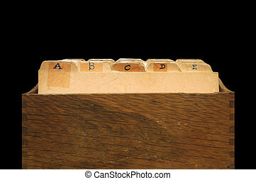 Alphabetical Indexed File Cabinet - A small wooden container...