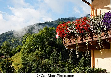 Alpine chalet balcony with flowers