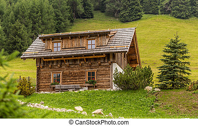 Alpine chalet in mountains on summer
