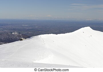 Alpine chapel on the snowy ridge