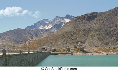 alpine dam - beautiful alpine panorama with dam