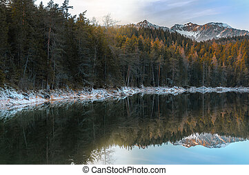 Alpine forest and snowy Alps near Eibsee lake