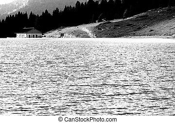 alpine hut on the shore of a beautiful alpine lake