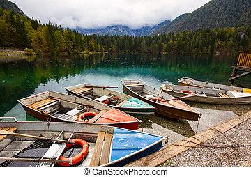 Alpine landscape and colorful boats, Lake Fusine,Italy -...