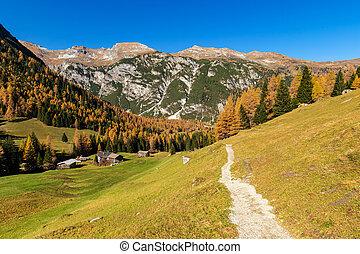 Alpine landscape in autumntime. Hiking in Austrian Alps, Tyrol, Austria.