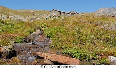 alpine landscape with stone-house