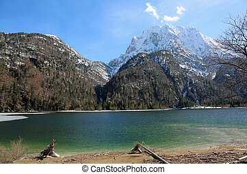alpine little lake called Predil Lake Northern Italy near...