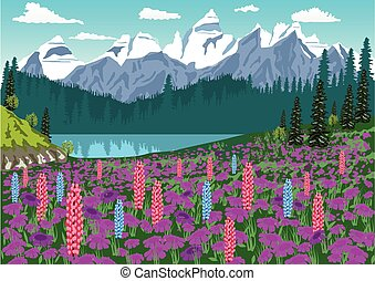 Alpine meadow with delphinium and rhododendrons in the Alps