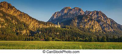 Alpine mountain landscape with famous Neuschwanstein Castleat sunset, Bavaria, Germany