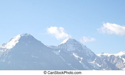 Alpine peaks landskape background. Jungfrau, Bernese highland. Alps, tourism and adventure hiking concept