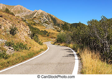 Alpine road, northern Italy. - Narrow road running through ...