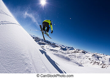 Alpine skier on piste, skiing downhill - Alpine skier in ...