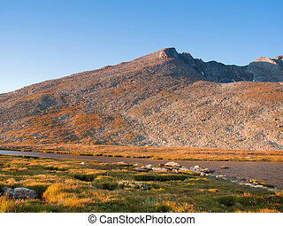 Beautiful Summit Lake reflects towering Mt. Evans and is surrounded by lush vegetation. Colorado.