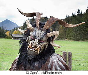 Alpine traditional Krampus mask - Man wearing traditional...