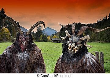 Alpine traditional Krampus masks - Two men wearing...