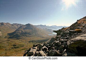 Alpine valley seen from rocky ridge